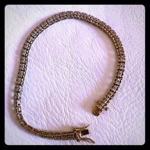 Jewelry - sterling and over gold tennis bracelet